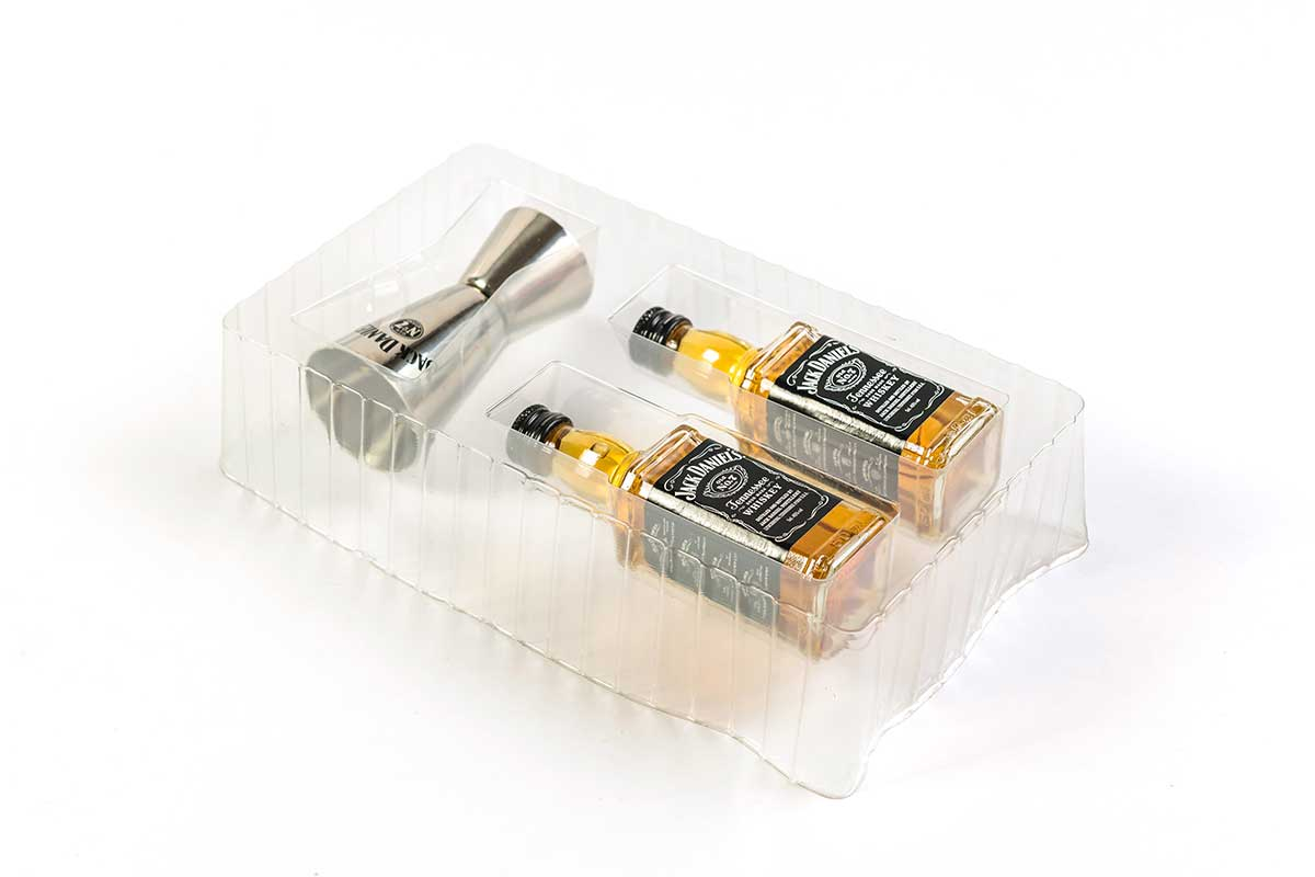 Interior packaging for two miniature Jack Daniel's and shot measure