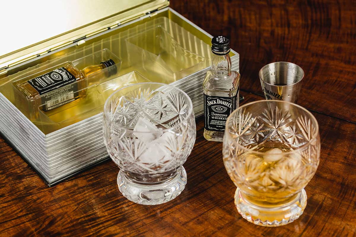 Jack Daniel's packaging with two glasses and ice, case and bottle