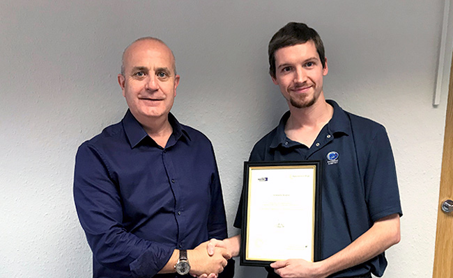 Chris Bowmen receives his Advanced Level Apprentice Award from Charpak Managing Director, Paul Smith